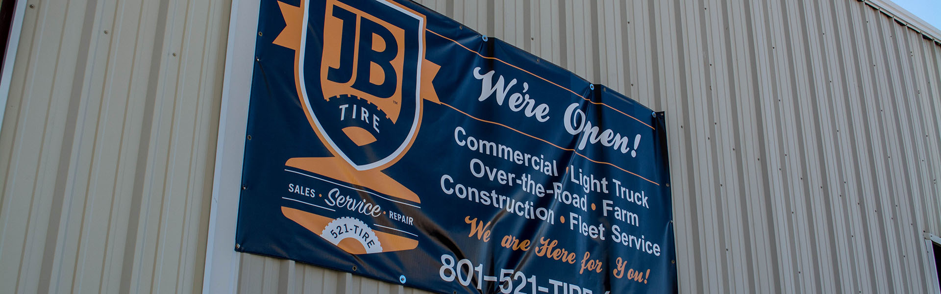 JB Tire Outside Wall Banner